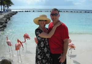 Dr. Robyn with her husband, Jason in Aruba on flamingo beach