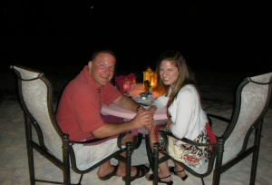 Dr. Robyn and Jason in Aruba at simply fish restaurant on the beach