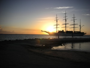 Dr. Robyn takes picture of Aruba Sunset with big boat