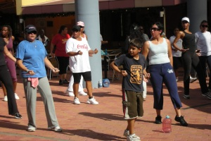 boy doing Latin dance class in Aruba